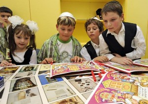 Jewish kids with art from top 10 Jewish kids celebrations