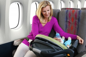 baby on airplane with mom