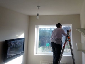 painting a wall in a bedroom