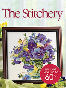 Picture of cross stitch catalogs from The Stitchery catalog