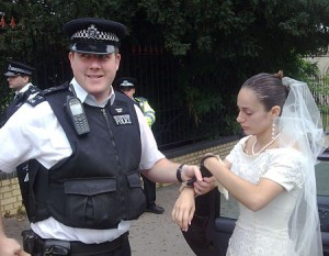 Taken away in cuffs from the ceremony is a wedding mishap