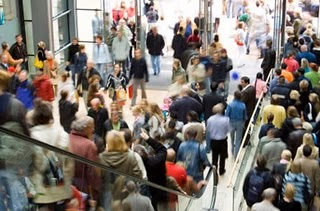 A crowded mall offers many opportunities for entertainment on spring break shopping trips