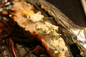 Grilled lobster served with truffle butter is an extravagant recipe