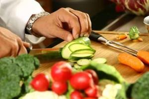 wok tips man cutting vegetables