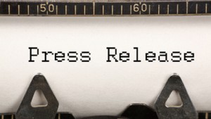 words press release on typewriter