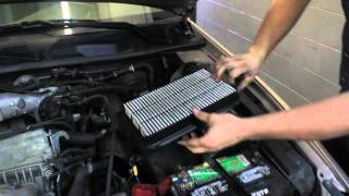 person changing oil filter
