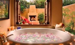 luxurious bath tub with rose petals