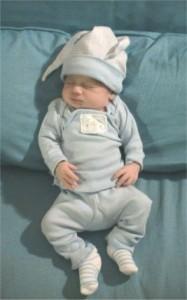 newborn in blue outfit