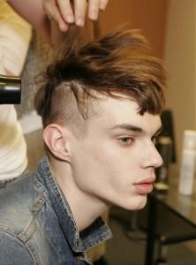 teen boy getting haircut
