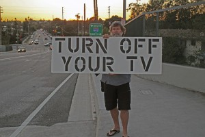 man with turn off tv sign