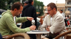 two men talking at coffee shop