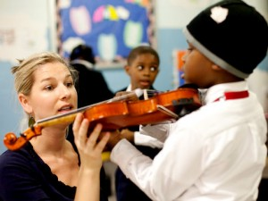 violin teacher and student