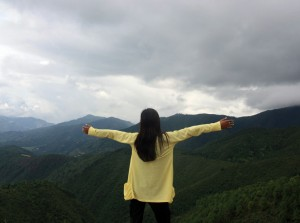 woman standing in hills