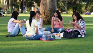 women sitting in park