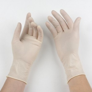 white surgical gloves on hands