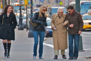 couple helping old man