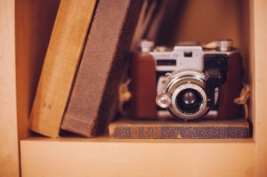 antique camera on bookshelf
