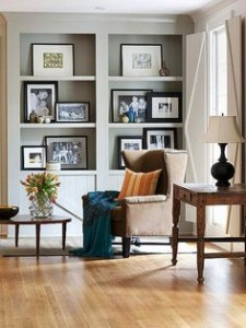 framed photos on shelf