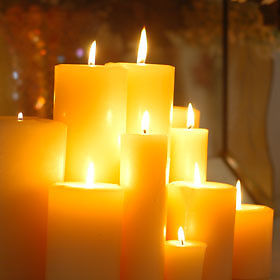 Lit group of beeswax candles