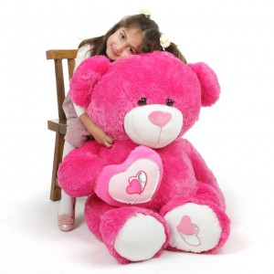 girl and giant pink bear