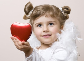 little girl holding a Valentines heart