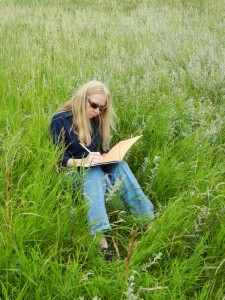 woman journaling in field