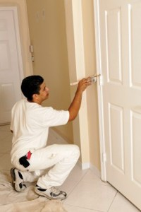 man painting interior door