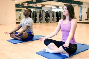 man and woman in yoga class