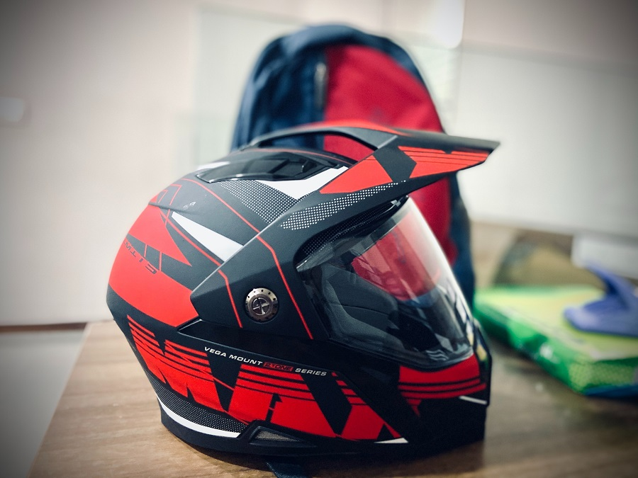 black and red snowmobile helmet