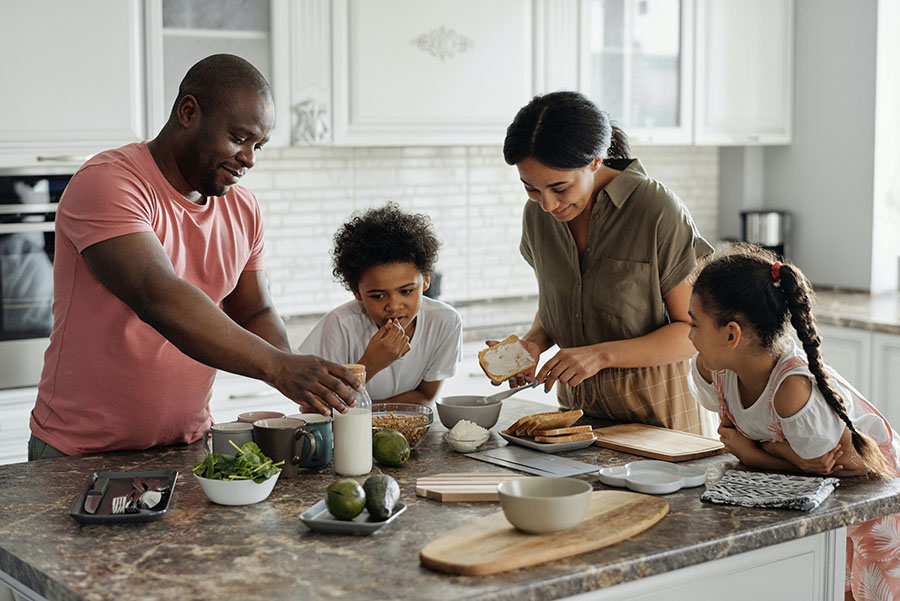A Family Cooking Dinner Together
