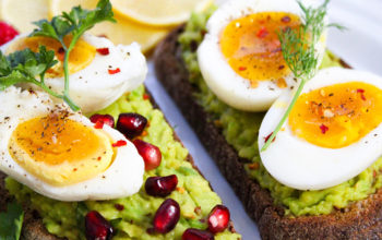 Avocado Toasts with Eggs, Herbs, and Pomegranate Seeds
