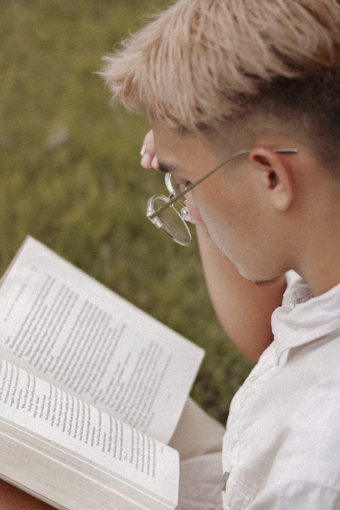 Person Reading a Book Outside