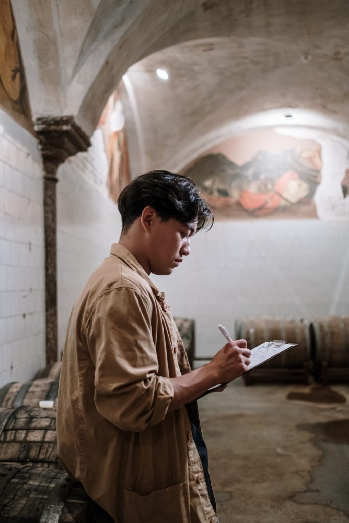 Man checking on winery