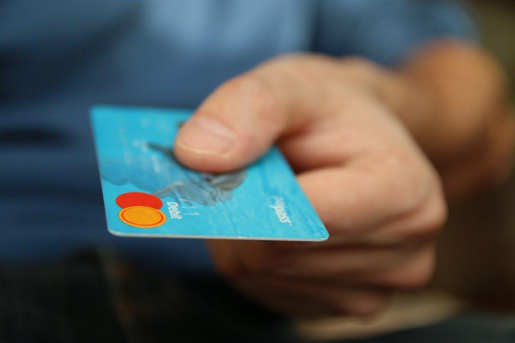 children using debit card to make payment